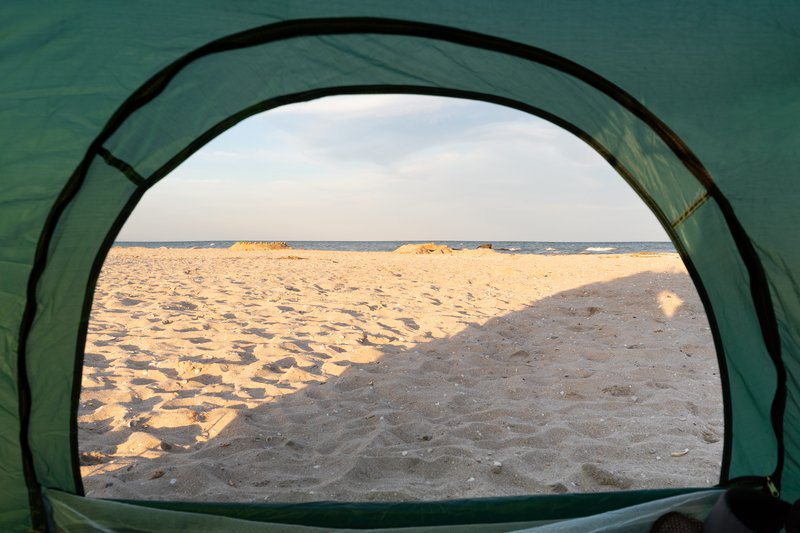 camping on the beach with essential beach camping gear