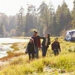 family camping outdoors near lake